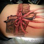 тату подвязка с пистолетом - фото готовой татуировки 01092016 6206 tatufoto.ru