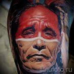 Фото тату портрет индейца - пол лица мужчины в красной краске