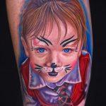Фото тату портрет ребенка - девочка с разрисованным лицом как у кошки