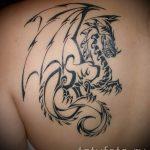 простая черная тату с драконом - фото пример 1
