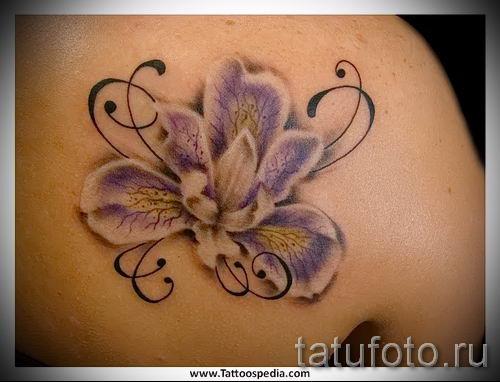 Фото пример тату ирис для статьи про значение татуировки с ирисом 11
