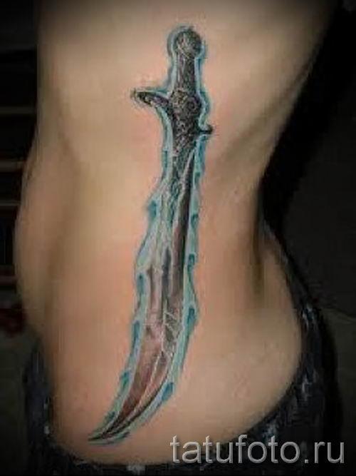 фото пример тату меч - картинка для статьи про значение татуировки 5