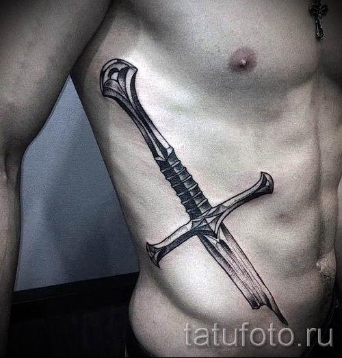 фото пример тату меч - картинка для статьи про значение татуировки 28