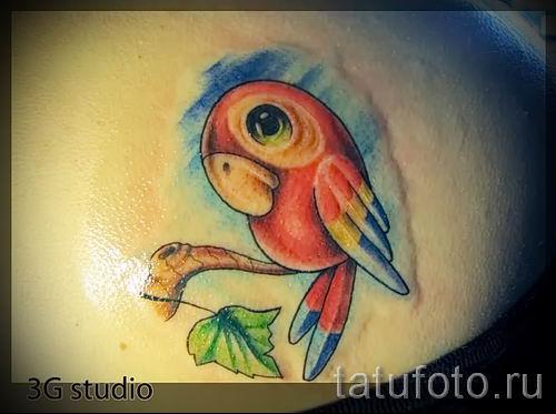 фото пример тату попугай для статьи про значение тату с попугаем - 26