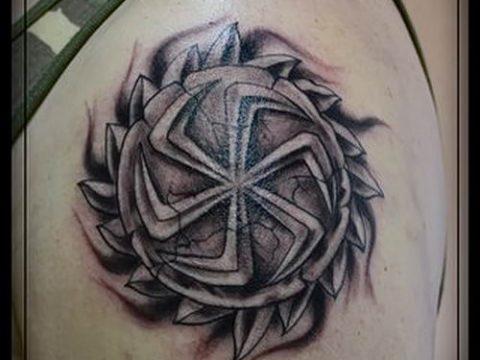 фото тату коловрат для статьи про значение татуировки коловрат - tatufoto.ru - 2
