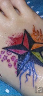 Оригинальный вариант татуировки радуга на фото – для публикации про значение рисунка радуги в тату