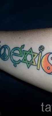 Крутой вариант наколки радуга на фото – для статьи про значение рисунка радуги в тату