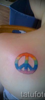 Прикольный вариант тату радуга на фотографии – для материала про значение рисунка радуги в тату
