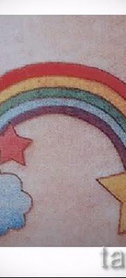 Оригинальный пример татуировки радуга на фотографии – для публикации про смыс рисунка радуги в тату