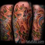 Крутой пример нанесенной татуировки жираф – рисунок подойдет для тату жираф акварель