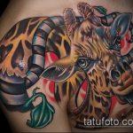 Интересный вариант нанесенной татуировки жираф – рисунок подойдет для тату жираф на предплечье