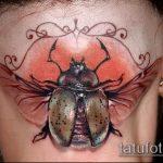 Интересный пример существующей наколки жук – рисунок подойдет для тату жук носорог