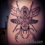 Оригинальный вариант выполненной наколки жук – рисунок подойдет для татуировка жук с крестом
