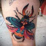 Оригинальный пример выполненной тату жук – рисунок подойдет для тату жук биомеханика