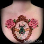Уникальный пример выполненной наколки жук – рисунок подойдет для татуировка жук с крестом
