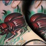 Классный пример выполненной наколки жук – рисунок подойдет для татуировка жук на руке