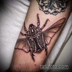 Уникальный вариант нанесенной татуировки жук – рисунок подойдет для тату жук носорог