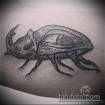 Классный пример выполненной татуировки жук – рисунок подойдет для тату жук биомеханика