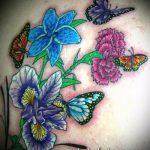 Крутой пример существующей татуировки ирис – рисунок подойдет для тату ирис на плече