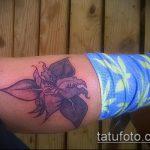Зачетный пример существующей татуировки ирис – рисунок подойдет для тату ирис на плече