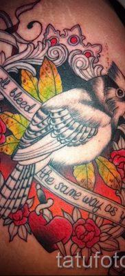 Классный вариант идеи наколки снегирь в готовой татухе на фото – для материала про смысл тату снегирь