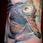 Интересный пример выполненной тату белка – рисунок подойдет для фото тату белка щелкает орешки