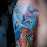фото тату дельфин №145 - классный вариант рисунка, который удачно можно использовать для преобразования и нанесения как фото тату дельфина на запястье