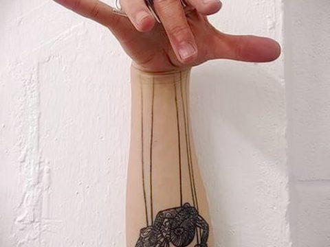 фото тату нитки с марионетка (tattoo) (значение) - пример рисунка - 010 tatufoto.com