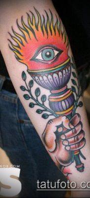 ТАТУИРОВКА ФАКЕЛ №94 – достойный вариант рисунка, который успешно можно использовать для переработки и нанесения как татуировка факел с лентой
