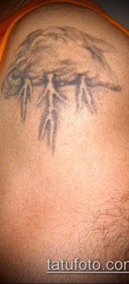 тату облака №701 – интересный вариант рисунка, который хорошо можно использовать для переработки и нанесения как тату солнце облака