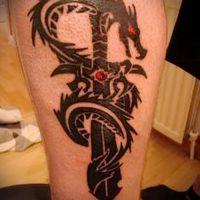 Значение тату дракон и меч