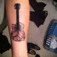 Значение тату гитара