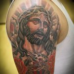Фото тату Иисуса Христа №2 - уникальный вариант рисунка, который легко можно использовать для переработки и нанесения как тату иисуса христа на спине