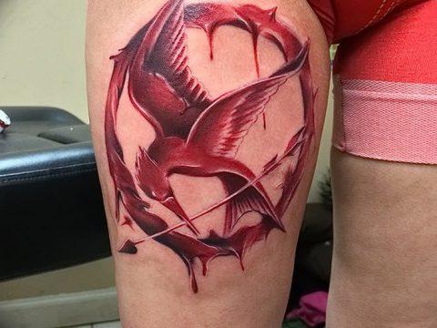 фото тату Сойка пересмешница от 25.09.2017 №045 - Tattoo Hunger Games - tatufoto.com