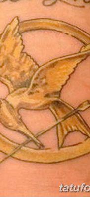 фото тату Сойка пересмешница от 25.09.2017 №060 – Tattoo Hunger Games – tatufoto.com