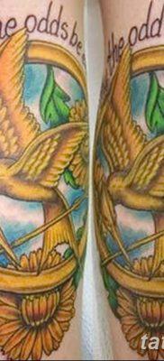 фото тату Сойка пересмешница от 25.09.2017 №067 – Tattoo Hunger Games – tatufoto.com