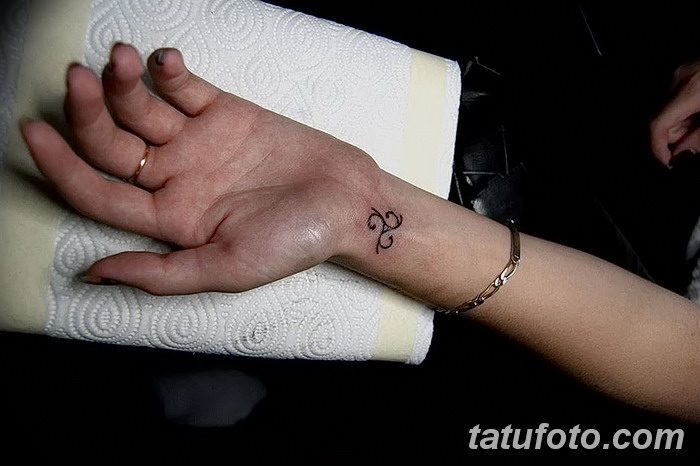 фото татуировка триксель от 23.10.2017 №074 - triksel tattoo - tatufoto.com