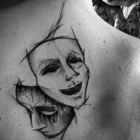 Значение тату две маски