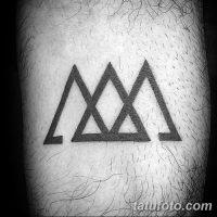 Значение тату «три треугольника»