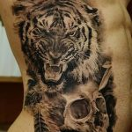 фото татуировка оскал тигра от 01.06.2018 №025 - tiger tattoo - tatufoto.com
