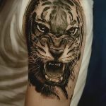 фото татуировка оскал тигра от 01.06.2018 №034 - tiger tattoo - tatufoto.com