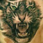 фото татуировка оскал тигра от 01.06.2018 №036 - tiger tattoo - tatufoto.com