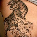 фото татуировка оскал тигра от 01.06.2018 №048 - tiger tattoo - tatufoto.com