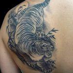 фото татуировка оскал тигра от 01.06.2018 №057 - tiger tattoo - tatufoto.com