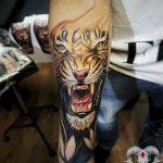 фото татуировка оскал тигра от 01.06.2018 №061 - tiger tattoo - tatufoto.com