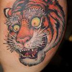 фото татуировка оскал тигра от 01.06.2018 №068 - tiger tattoo - tatufoto.com