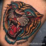 фото татуировка оскал тигра от 01.06.2018 №072 - tiger tattoo - tatufoto.com