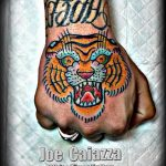 фото татуировка оскал тигра от 01.06.2018 №080 - tiger tattoo - tatufoto.com