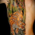 фото татуировка оскал тигра от 01.06.2018 №110 - tiger tattoo - tatufoto.com