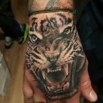фото татуировка оскал тигра от 01.06.2018 №112 - tiger tattoo - tatufoto.com